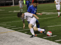Junior Ulysses Sixtos dribbles the ball away from the opponent. Photo by Maya Girimaji