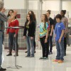 Photo of the day: Choir members prepare for Christmas concert