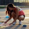 Students, parents paint parking spaces for first time in Consol history