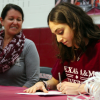 Varsity seniors in volleyball, cross country, basketball sign with colleges